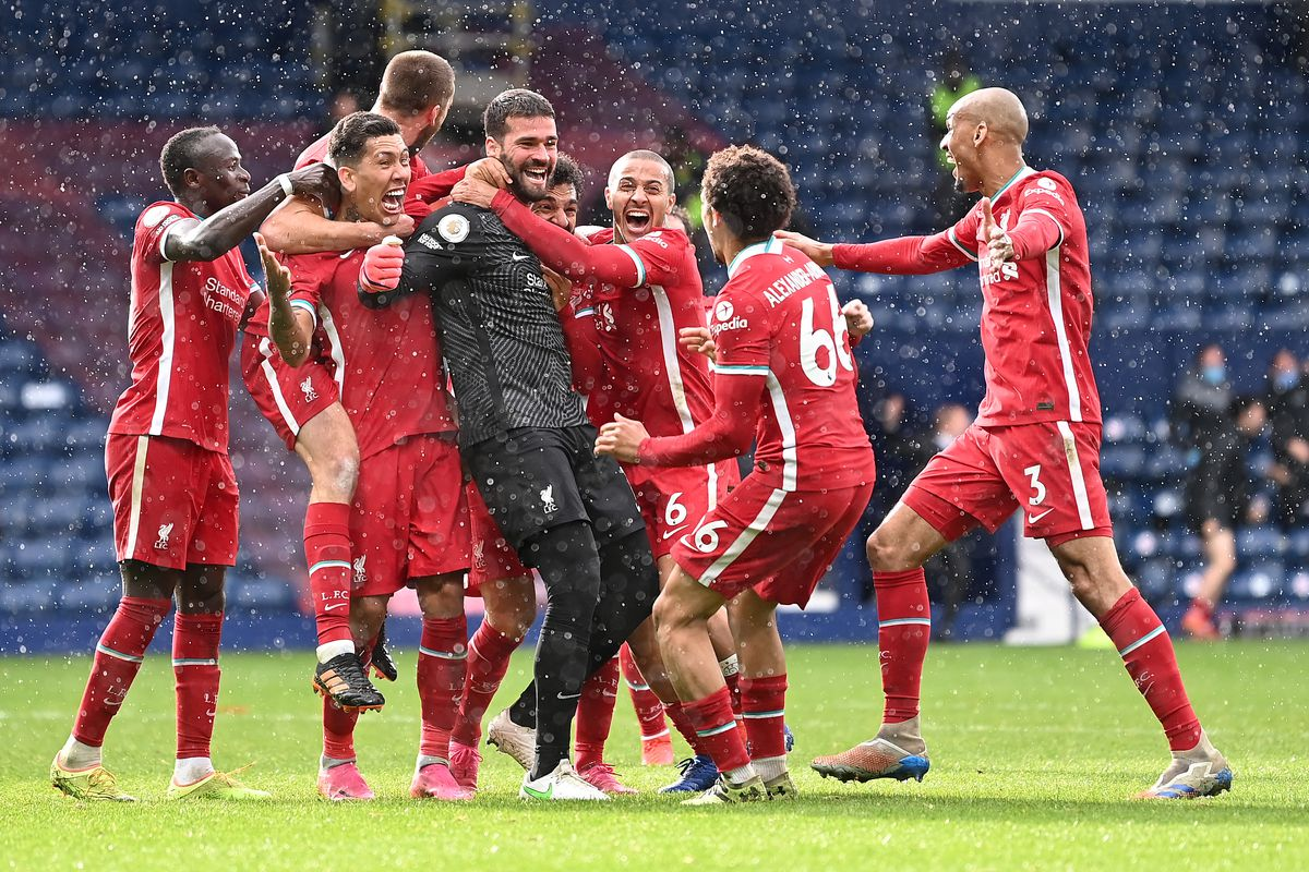Alisson Becker of Liverpool is congratulated by Sadio Mane, Roberto Firmino, Thiago Alcantara, Trent Alexander-Arnold and Fabinho after scoring the winning goal during the Premier League match between West Bromwich Albion and Liverpool at The Hawthorns