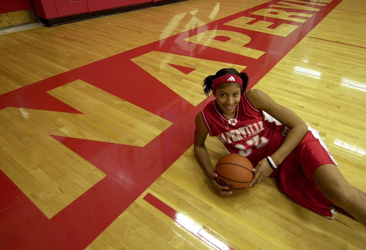 Candace Parker poses in the Naperville Central gym in 2003. High School, is seen in the gym in 2003.