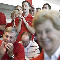 University of Utah supporters react as it is voted on to accept the invitation to the U. to join the Pac-10 Athletic Conference at Rice-Eccles Stadium on the campus of the U. in Salt Lake City Thursday.