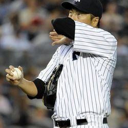 New York Yankees starting pitcher Hiroki Kuroda reacts after Baltimore Orioles' Matt Wieters hit a single in the second inning of a baseball game on Friday, Aug., 31, 2012, at Yankee Stadium in New York.