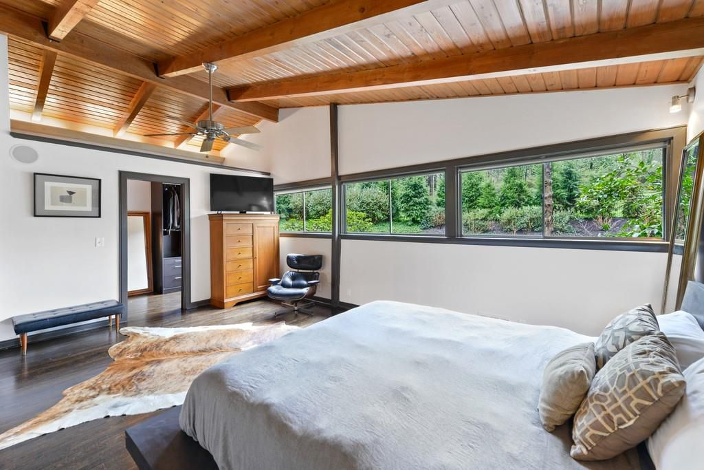 A huge master bedroom with a wood ceiling.