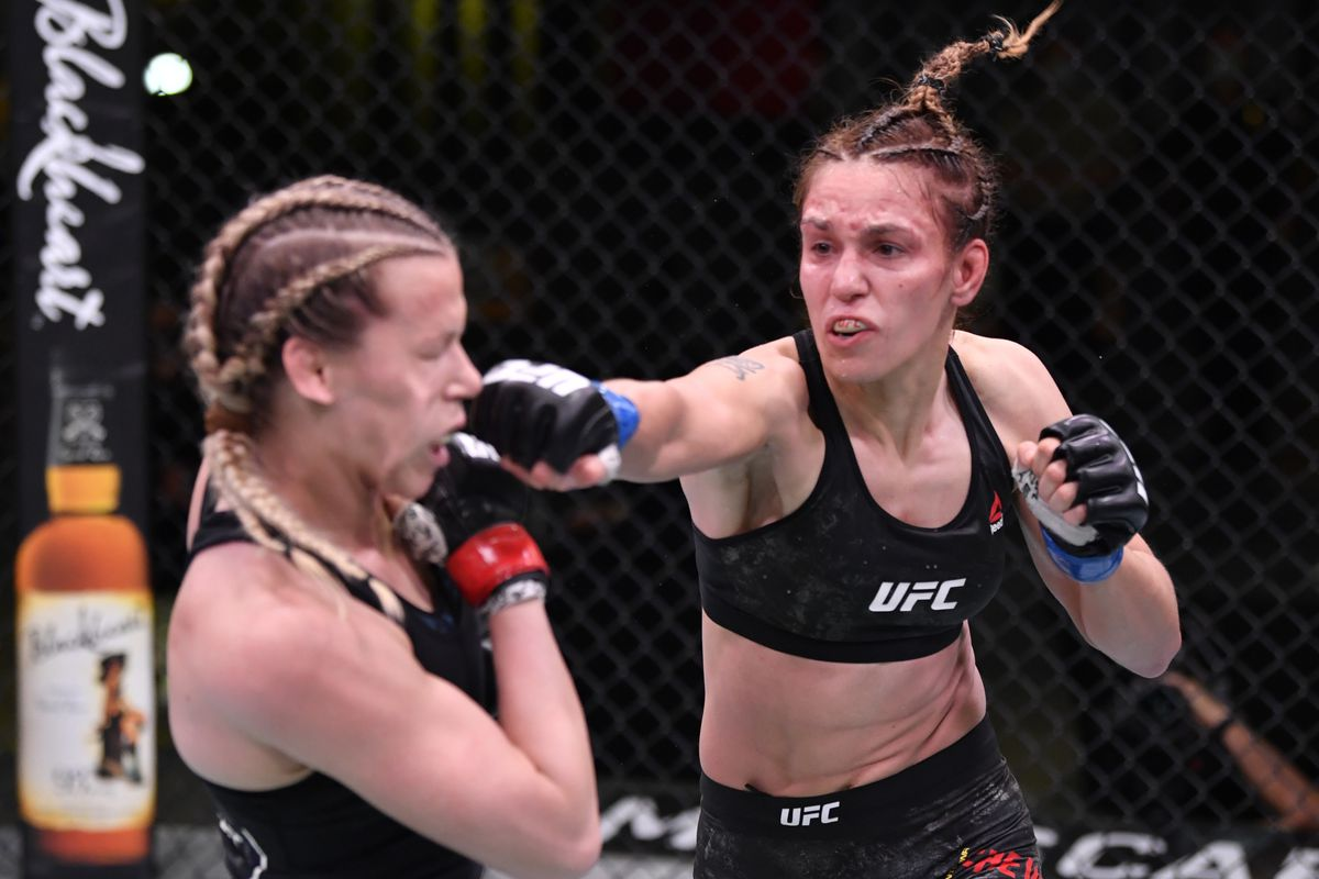 Antonina Shevchenko of Kyrgyzstan punches Katlyn Chookagian in their flyweight fight during the UFC Fight Night event at UFC APEX on May 30, 2020 in Las Vegas, Nevada.