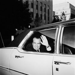 In this Oct. 29, 1980, file photo former President Richard Nixon waves as he leaves the U.S. District Court in Washington after testifying.
