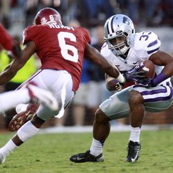 Kansas State runing back John Hubert (33) carries as Oklahoma defender Demontre Hurst (6) moves in, during the first quarter of an NCAA college football game in Norman, Okla., Saturday, Sept. 22, 2012.