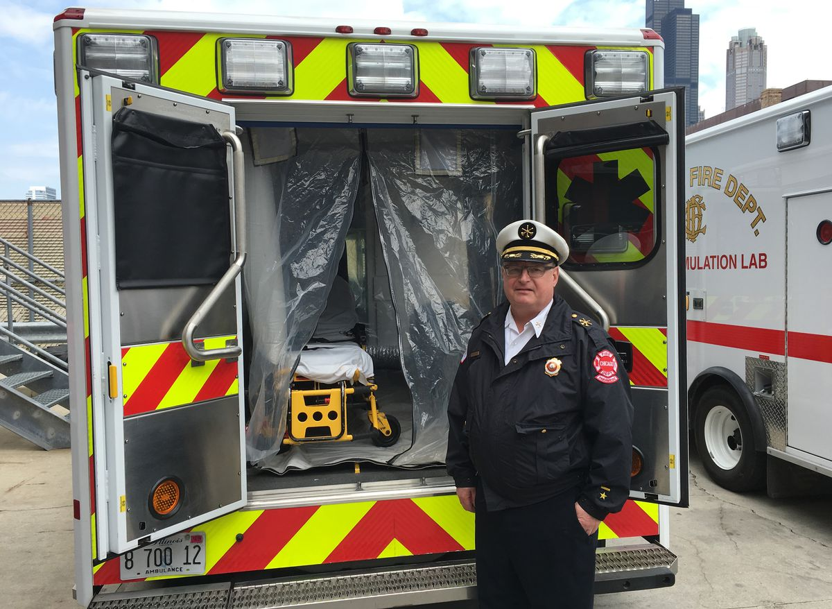 Fire Department Assistant Deputy Chief Paul Roszkowski shows off the department's first ambulance equipped to treat someone infected by the Ebola virus. | Mitch Dudek/Sun-Times