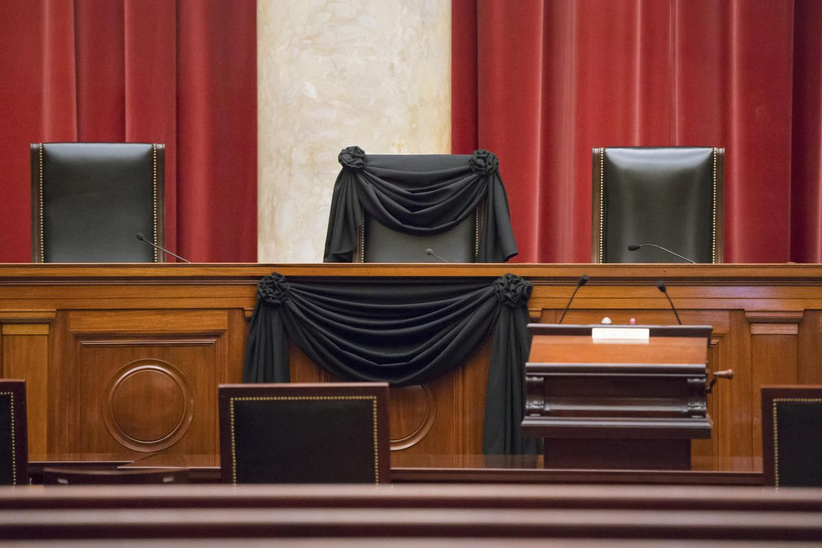 Supreme Court Justice Antonin Scalia's courtroom chair is draped in black to mark his death as part of a tradition that dates to the 19th century, Tuesday, Feb. 16, 2016, at the Supreme Court in Washington. Scalia died Saturday at age 79. He joined the co