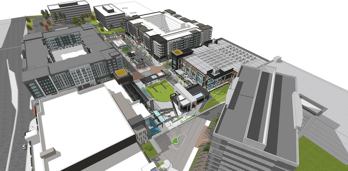 An aerial rendering of the project shows new city blocks dissected by pedestrian space.