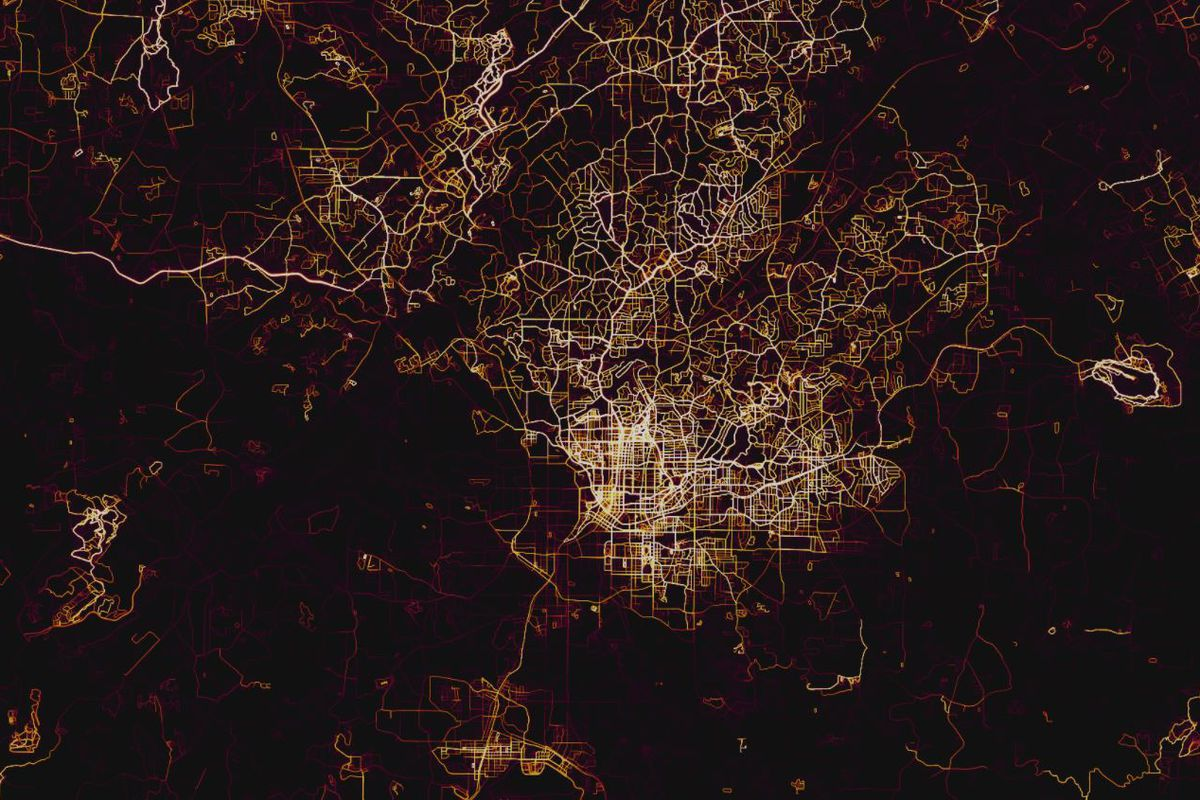 A black map with the grid of the city glowing from a light purple to red to white, showing where people exercise.