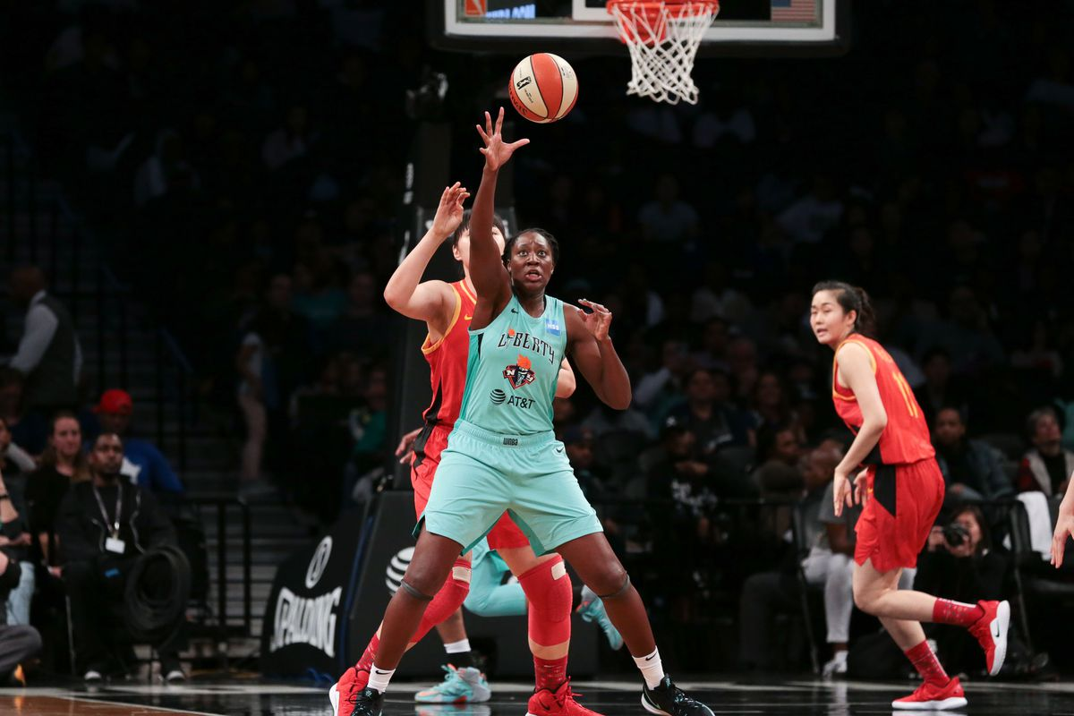 New York Liberty center Tina Charles catches a pass during the preseason WNBA game against the China National Team at Barclays Center.