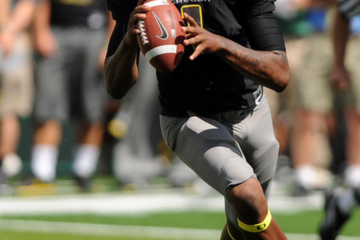 EUGENE OR - SEPTEMBER 04: Quarterback Darron Thomas #1 of the Oregon Ducks rolls out to pass in the first quarter of the game against the New Mexico Lobos at Autzen Stadium on September 4 2010 in Eugene Oregon.  (Photo by Steve Dykes/Getty Images)