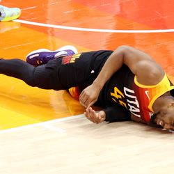 Utah Jazz guard Donovan Mitchell (45) rolls over in obvious pain after falling to the floor as the Utah Jazz and Memphis Grizzlies play Game 2 of their NBA playoffs first round series at Vivint Arena in Salt Lake City on Wednesday, May 26, 2021. Utah won 141-129.