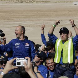Sebastian Thrun, left, seen here celebrating with the Stanford Racing Team, has started Udacity, an online educational venture.