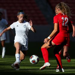 Fremont's Ashlyn Gwynn moves the ball upfield toward American Fork's Pyper Cuff in a 6A girls soccer semifinal game at Rio Tinto Stadium in Sandy on Tuesday, Oct. 20, 2020.