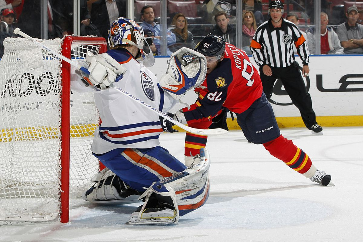 SUNRISE, FL - MARCH 23: Goaltender Devan Dubnyk #40 of the Edmonton Oilers stops a shot by Tomas Kopecky #82 of the Florida Panthers on March 23, 2012 at the BankAtlantic Center in Sunrise, Florida. (Photo by Joel Auerbach/Getty Images)