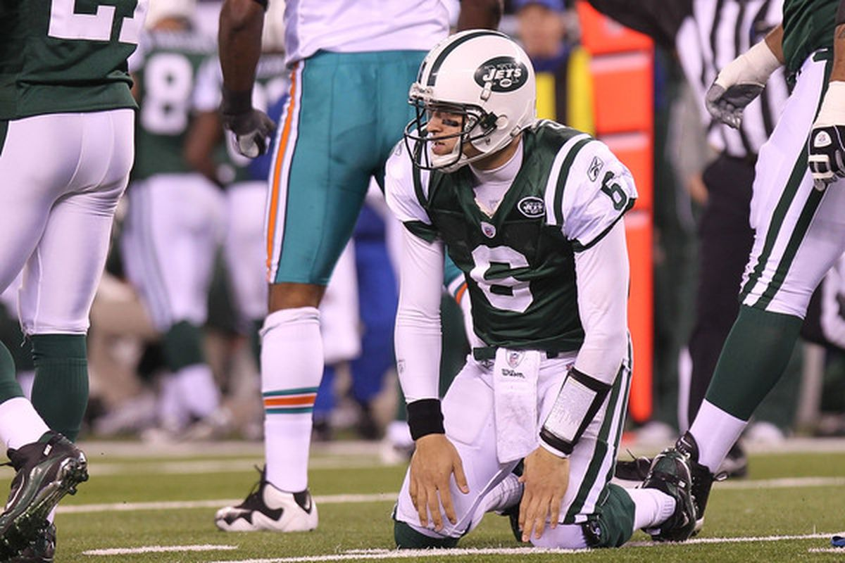 Mark Sanchez (6) and the New York Jets have been staggered by consecutive losses.  (Photo by Nick Laham/Getty Images)