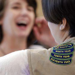 Girl Scouts of Western Washington CEO Megan Ferland, left, talks with Girl Scout Sierra Stauffer. | AP Photo