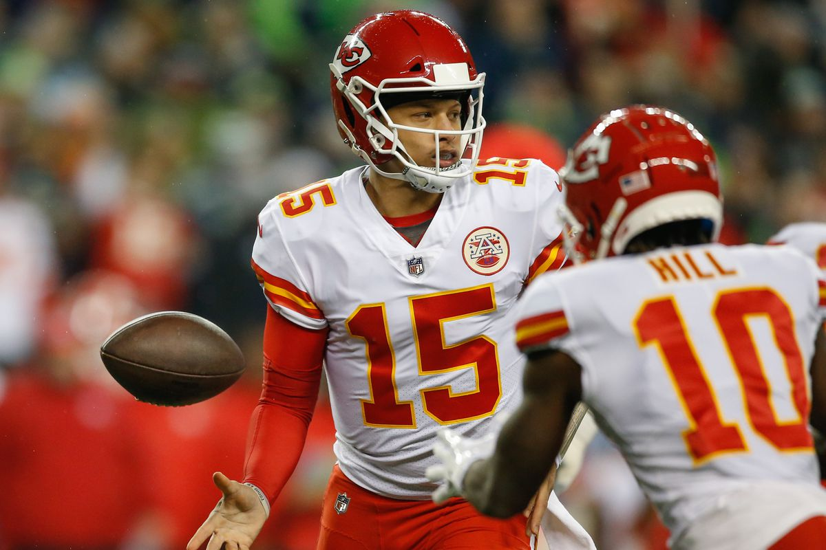 Quarterback Patrick Mahomes of the Kansas City Chiefs flips the ball to wide receiver Tyreek Hill against the Seattle Seahawks at CenturyLink Field on December 23, 2018 in Seattle, Washington.