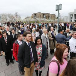 Conferencegoers wait in lines to enter the Conference Center in Salt Lake City prior to the Sunday morning session of the LDS Church's 187th Annual General Conference on Sunday, April 2, 2017.