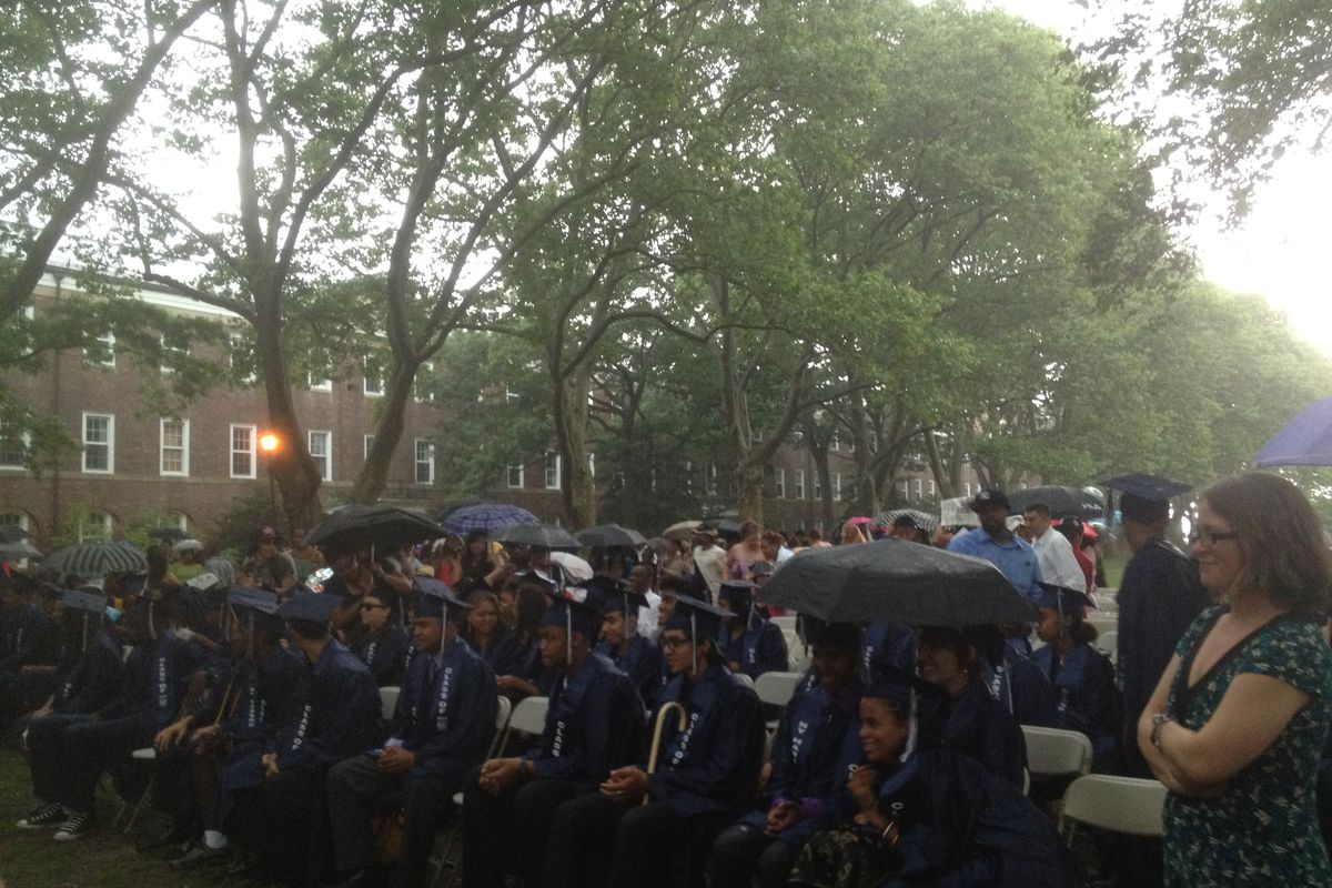 Students listened to their valedictorian in the rain, before lightning caused the ceremony to be moved inside.