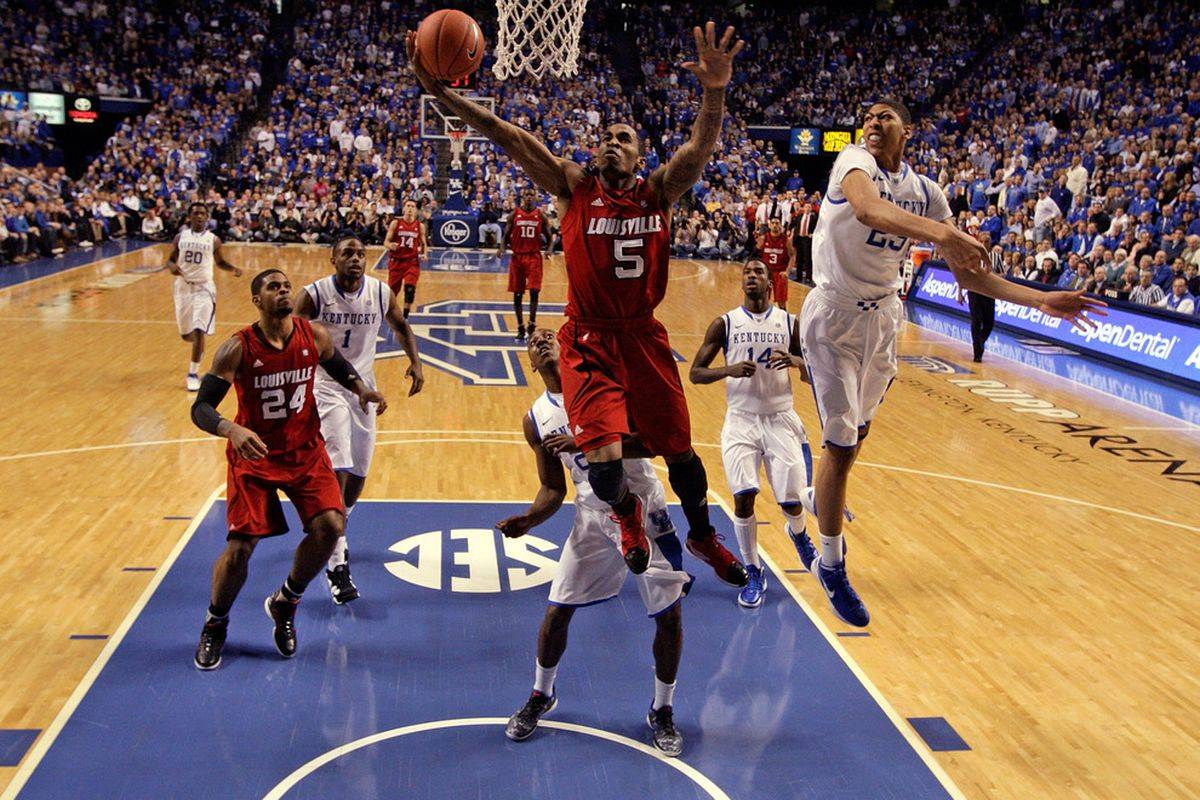 LEXINGTON, KY - DECEMBER 31:  Chris Smith #5 of the Louisville Cardinals shoots the ball during 69-62 loss to the Kentucky Wildcats at Rupp Arena on December 31, 2011 in Lexington, Kentucky.  (Photo by Andy Lyons/Getty Images)