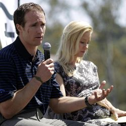 New Orleans Saints football quarterback Drew Brees, left, speaks at a news conference for his charity golf tournament alongside his wife, Brittany Brees, Tuesday, April 10, 2012, in Carlsbad, Calif.