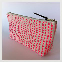 """<strong>Early Girl Ink</strong> Zipper Clutch in Pink Party Light Print, <a href=""""http://www.earlygirlink.com/product/zipper-pouch-in-pink-party-light-print"""">$24</a>"""