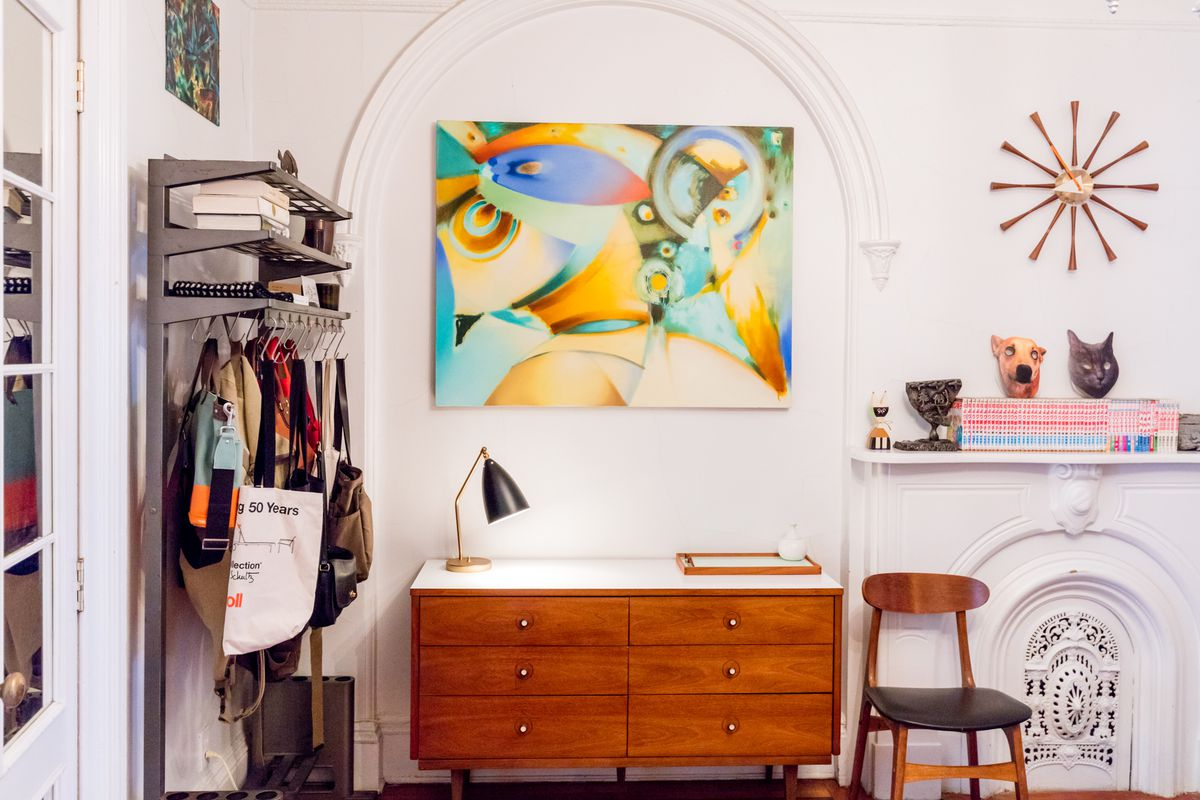 Vintage finds in the eclectic Brooklyn apartment of a Design Within Reach buyer includes a thrifted coat rack.