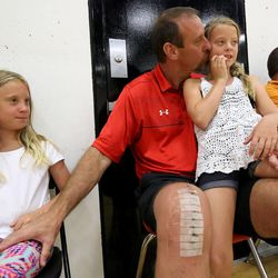 Larry Krystkowiak, head coach for the Utah Runnin' Utes basketball team, watches his 12-year-old son play basketball with his twin daughters Finley, left, and Sam at the University of Utah in Salt Lake City on Friday, June 12, 2015.