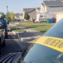 Law enforcement officials from Davis County investigate the deaths of two young boys Thursday, May 23, 2013, in West Point.