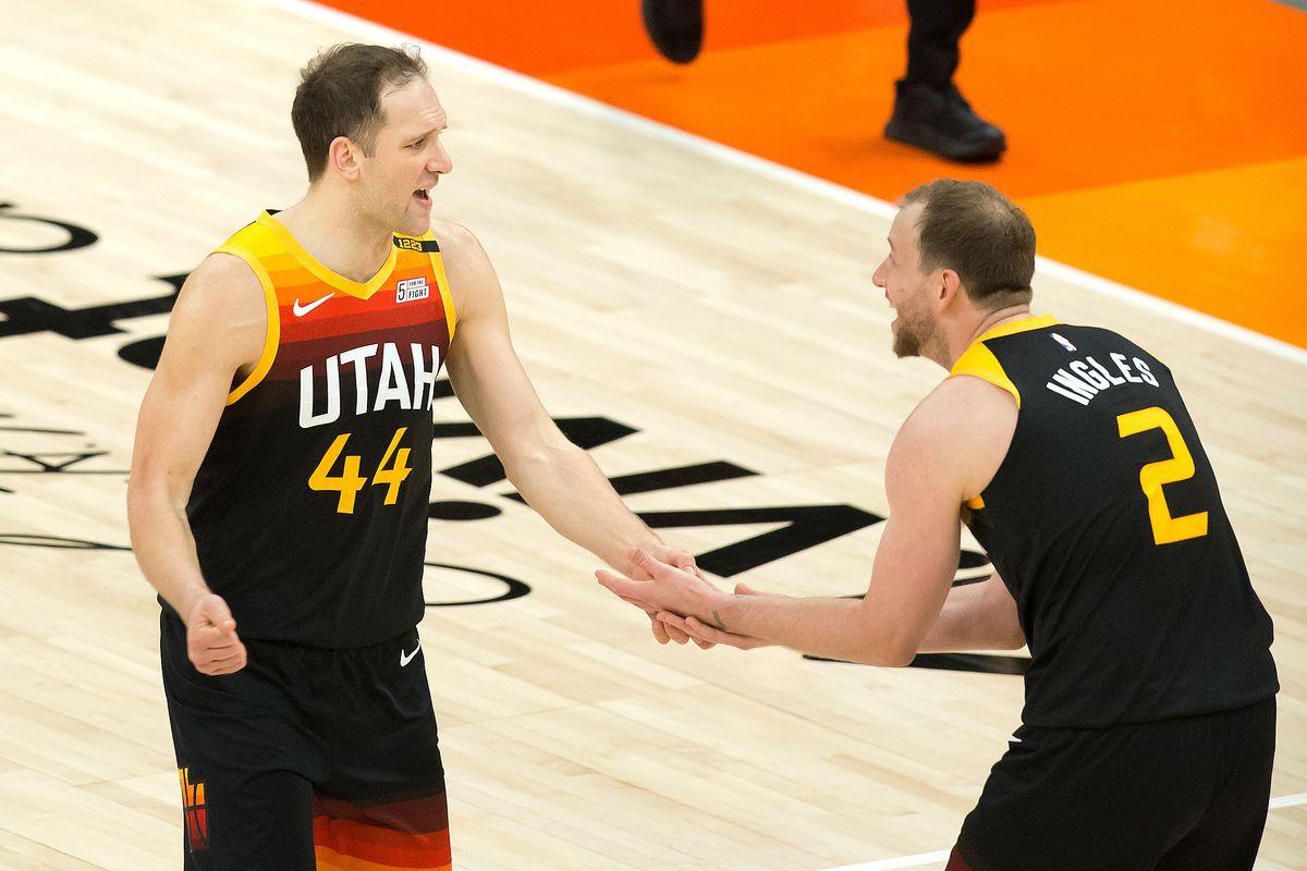 Utah Jazz forward Bojan Bogdanovic and forward Joe Ingles react during the second half against the Miami Heat at Vivint Smart Home Arena.