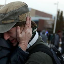 Perrin Henriksen, a senior at Pleasant Grove High School, hugs his mother after a lockdown at the high school was lifted Thursday, Dec. 3, 2015. Pleasant Grove High School was placed on lockdown after receiving reports of a man with a weapon inside the school.