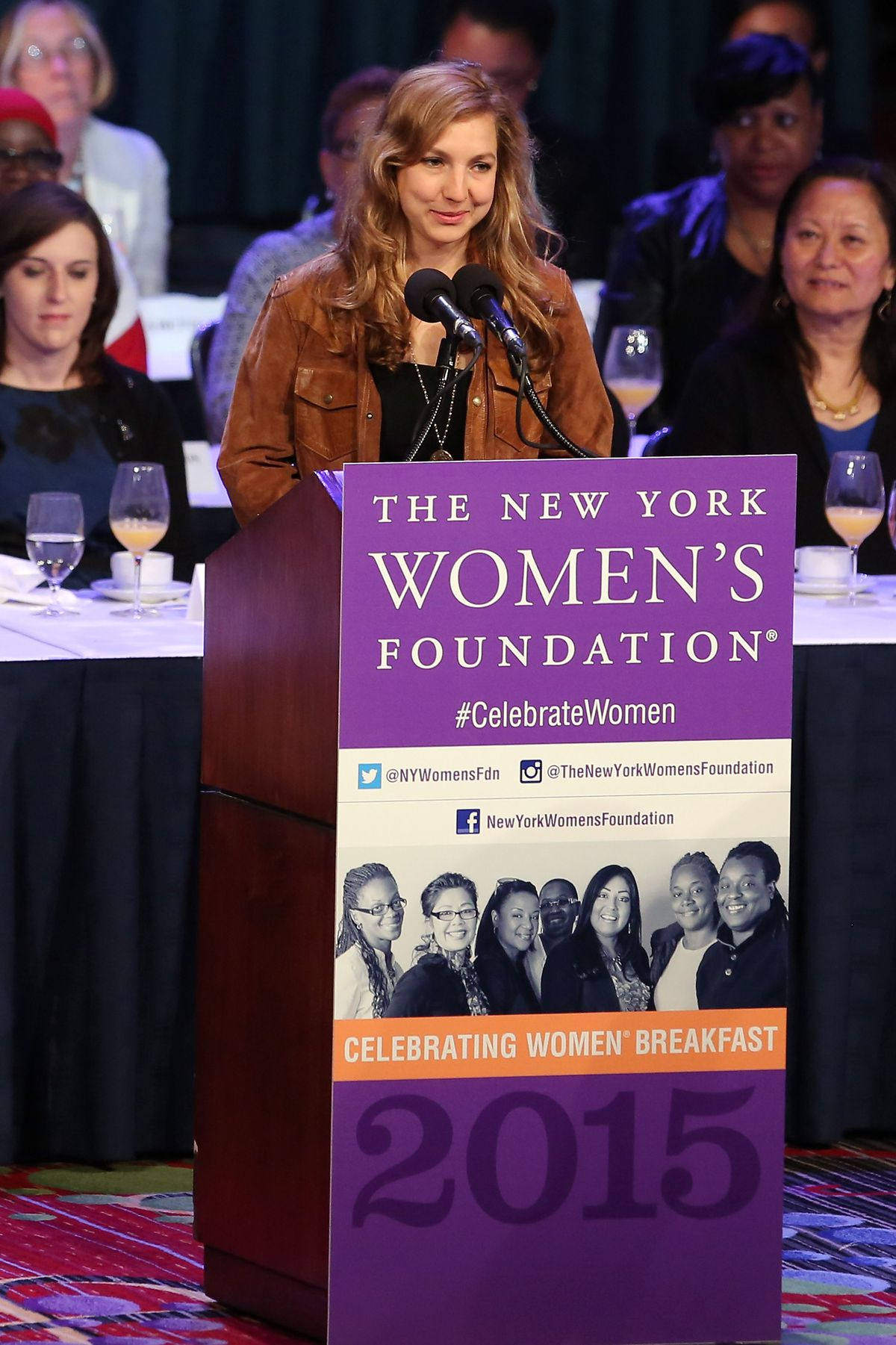 Leah Hunt-Hendrix speaks at an rostrum at an event hosted by the Women's Foundation.