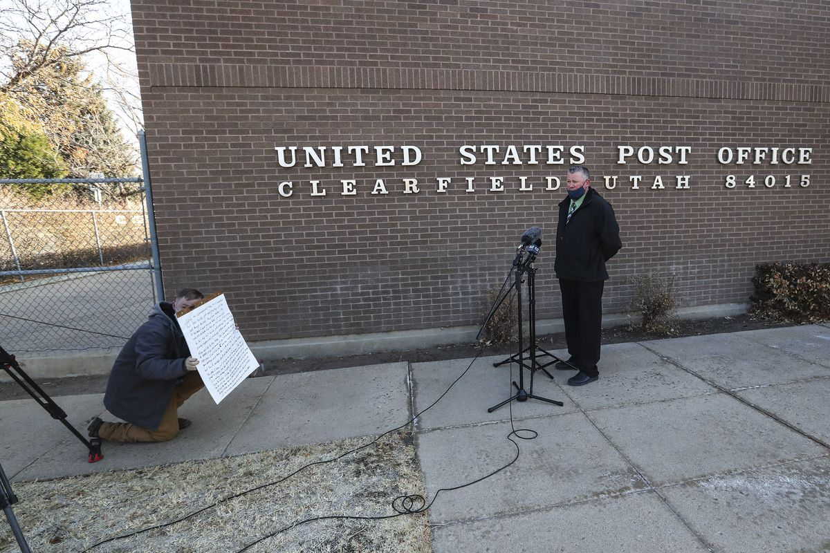 Clearfield Postmaster Scott Mangels talks about best shipping practices for getting gifts to military service people during the holidays outside the Clearfield post office on Monday, Dec. 7, 2020.