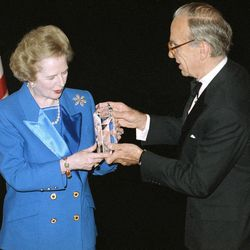 FILE - In this Nov. 14, 1991, file photo, Margaret Thatcher accepts the United Cerebral Palsy of New York's 37th Annual Humanitarian Award in New York from Rupert Murdoch.