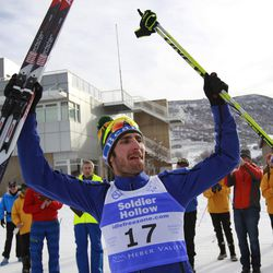 Taylor Fletcher, of the USA, celebrates his first place finish in the cross-country skiing portion of the FIS Nordic Combined Continental Cup, Sunday, Dec. 13, 2015, in Midway, Utah. (AP Photo/George Frey)