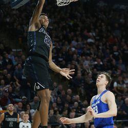 Utah State Aggies forward Dwayne Brown Jr. (25). Slams on Brigham Young Cougars forward Yoeli Childs (23) in Logan on Saturday, Dec. 2, 2017. BYU won 75-66.