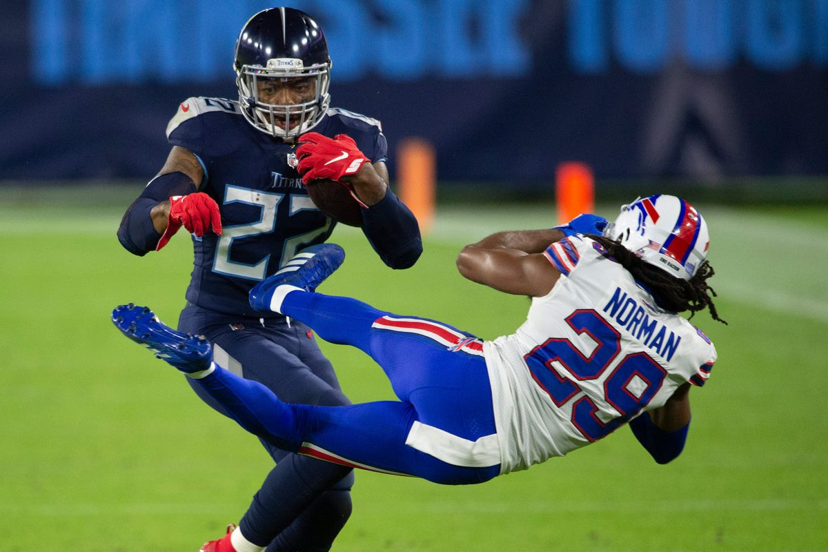 Tennessee Titans running back Derrick Henry (22) throws Buffalo Bills cornerback Josh Norman (29) aside as he rushes up the field during the second quarter at Nissan Stadium Tuesday