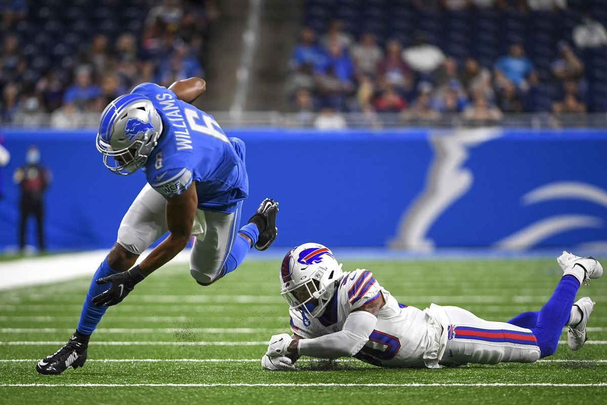 Tyrell Williams #6 of the Detroit Lions breaks a tackle against Dane Jackson #30 of the Buffalo Bills during the first quarter of the preseason game at Ford Field on August 13, 2021 in Detroit, Michigan.