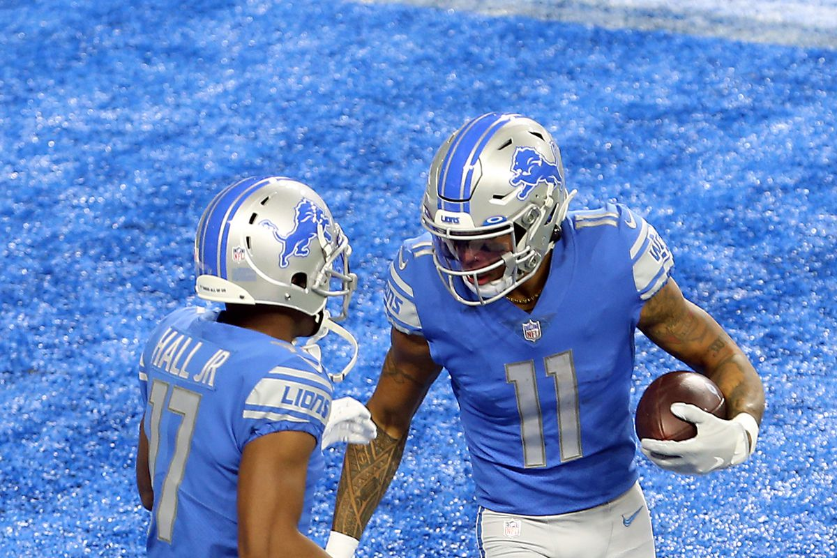 Detroit Lions wide receiver Marvin Jones (11) is congratulated by Detroit Lions wide receiver Marvin Hall (17) after making a touchdown under the pressure of Indianapolis Colts cornerback Kenny Moore II (23) during the first half of an NFL football game against the Indianapolis Colts in Detroit, Michigan USA, on Sunday, November 1, 2020.
