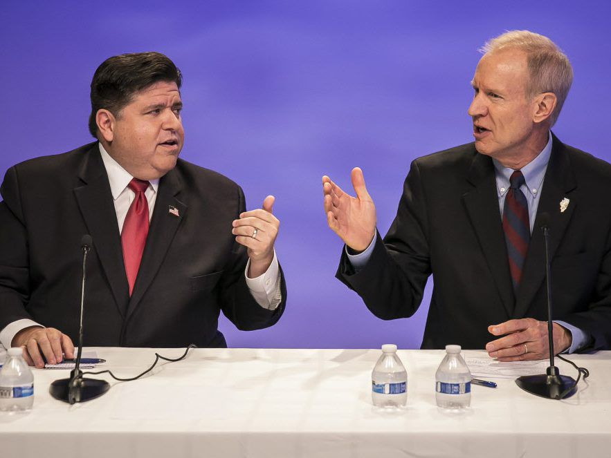 Republican Gov. Bruce Rauner, right, and his Democratic challenger J.B. Pritzker faced-off in a debate in Chicago before the Sun-Times Editorial Board. (Rich Hein/Chicago Sun-Times via AP File) ORG XMIT: ILCHS301