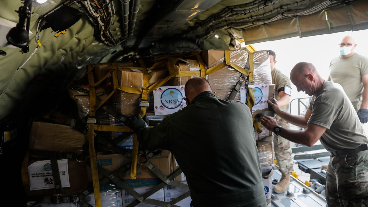 Members of the United States Utah Air National Guard's 151st Air Refueling Wing loads equipment and supplies to assist Nepal's COVID-19 response onboards the KC-135 on Thursday, Aug. 26, 2021 at Roland R. Wright Air National Guard Base in Salt Lake City.