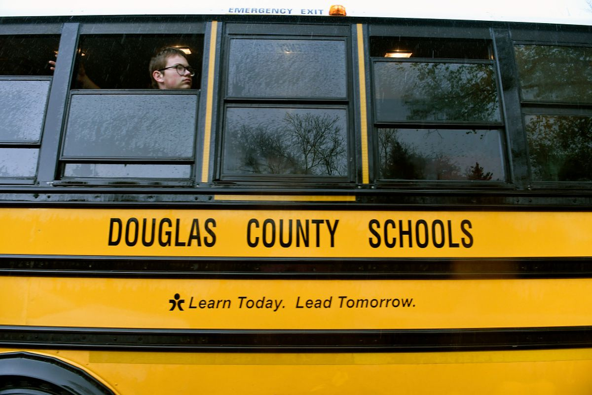 One students looks out the window of a Douglas County school bus.