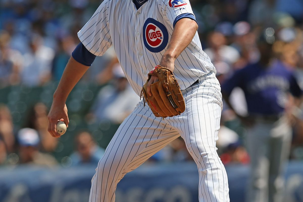 CHICAGO, IL - AUGUST 24:  Starting pitcher Jeff Samardzija #29 of the Chicago Cubs delivers the ball against the Colorado Rockies at Wrigley Field on August 24, 2012 in Chicago, Illinois.  (Photo by Jonathan Daniel/Getty Images)