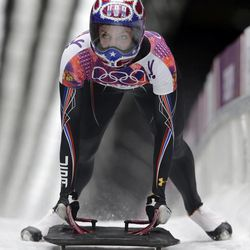 Noelle Pikus-Pace of the United States brakes after her third run during the women's skeleton competition at the 2014 Winter Olympics, Friday, Feb. 14, 2014, in Krasnaya Polyana, Russia. (AP Photo/Dita Alangkara)