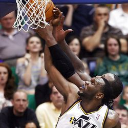 Utah Jazz center Al Jefferson (25) battles with Orlando's #11 Glen Davis for the ball under the basket as the Utah Jazz and the Orlando Magic play Saturday, April 21, 2012 in Energy Solutions arena.
