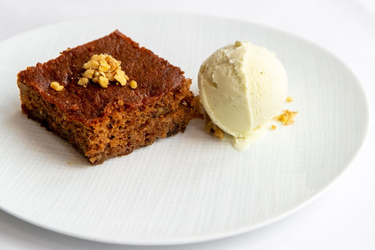 Karidopita, walnut-based cake with ice cream