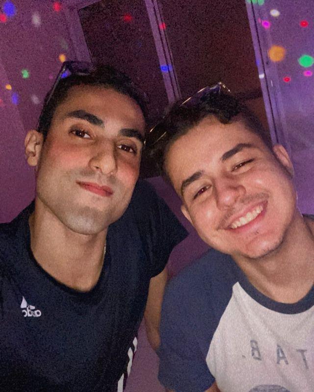 Douglas Souza, left, with his boyfriend, Gabriel.