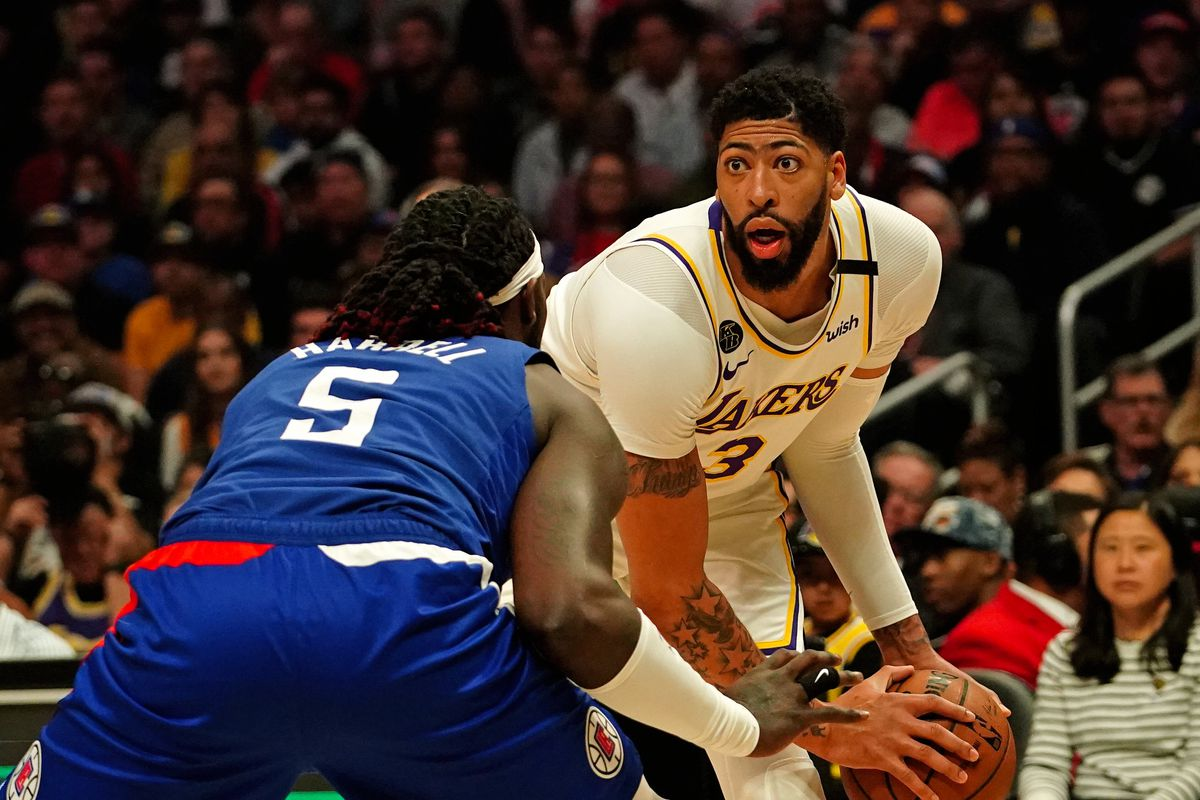 Los Angeles Lakers forward Anthony Davis is guarded by LA Clippers forward Montrezl Harrell in the first half at Staples Center.