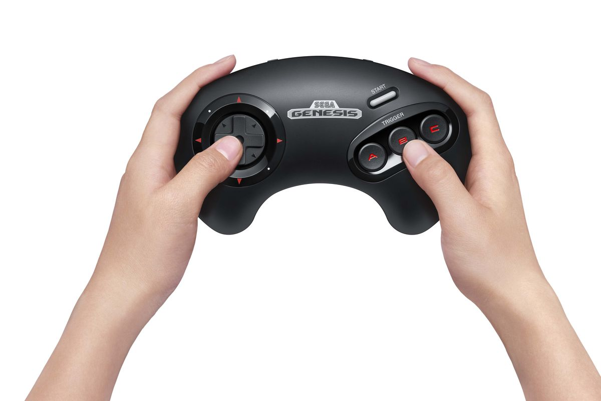 two hands holding a Sega Genesis controller for the Nintendo Switch