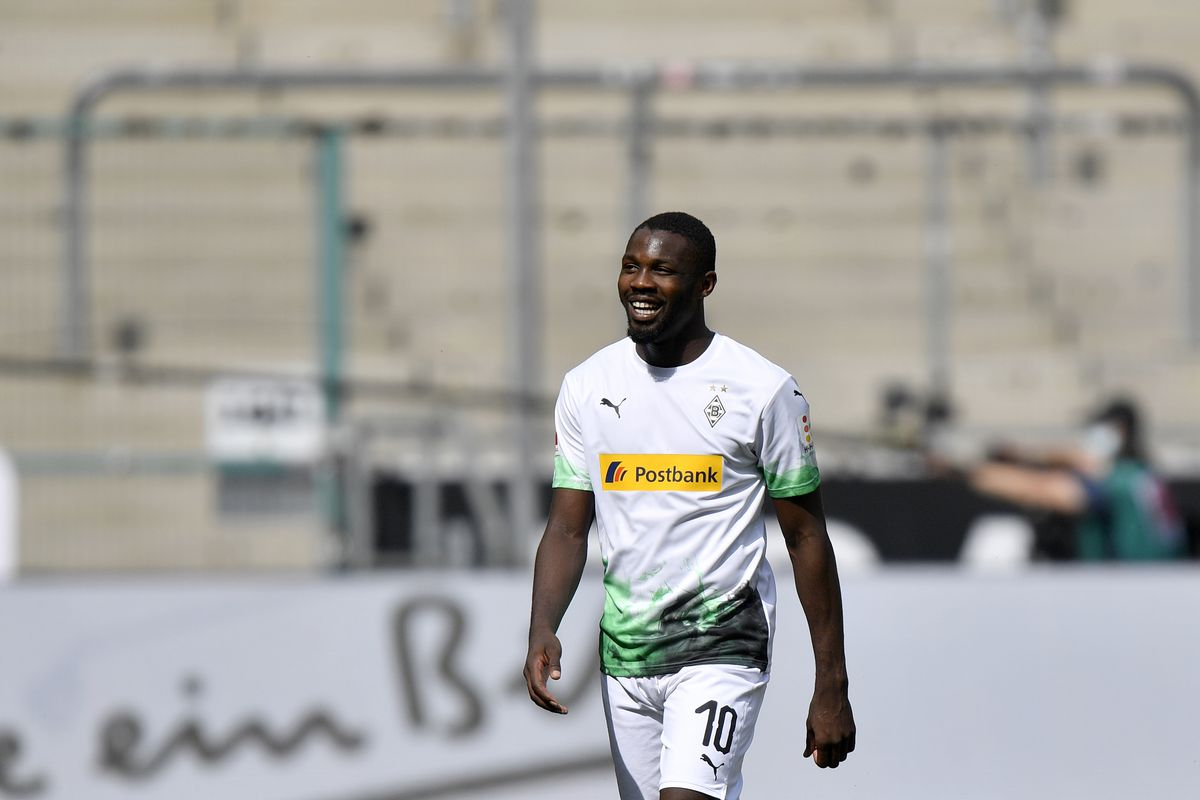 Moenchengladbach's Marcus Thuram, second left, celebrates after he scores his side's third goal during the Bundesliga match between Borussia Moenchengladbach and 1. FC Union Berlin at Borussia-Park on May 31, 2020 in Moenchengladbach, Germany.